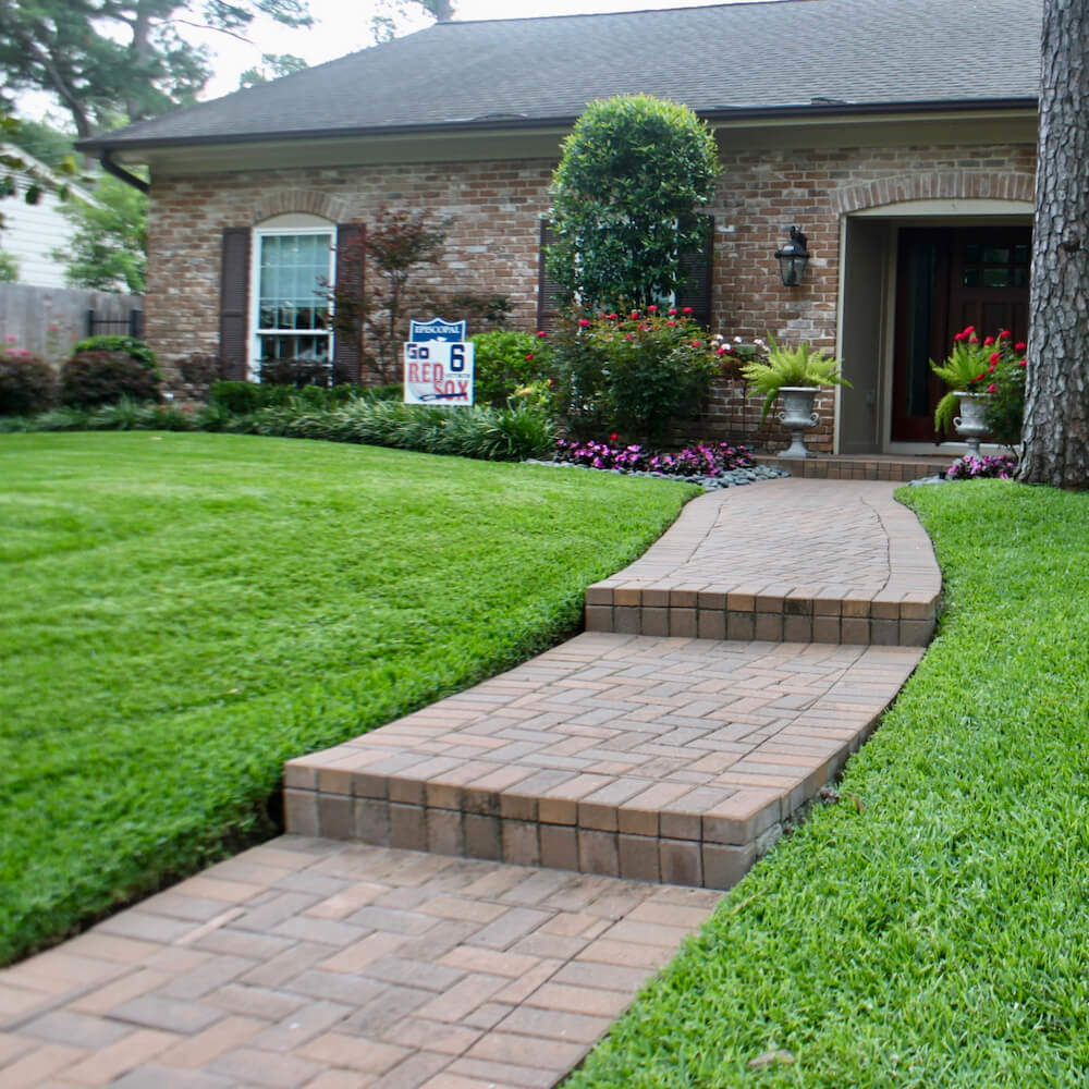 front yard landscape paver entry 77024